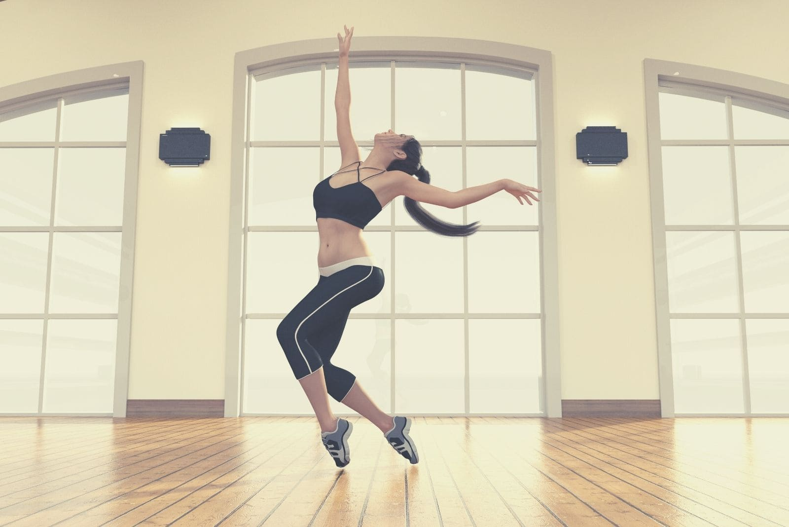 woman dancing freestyle alone inside a dance studio