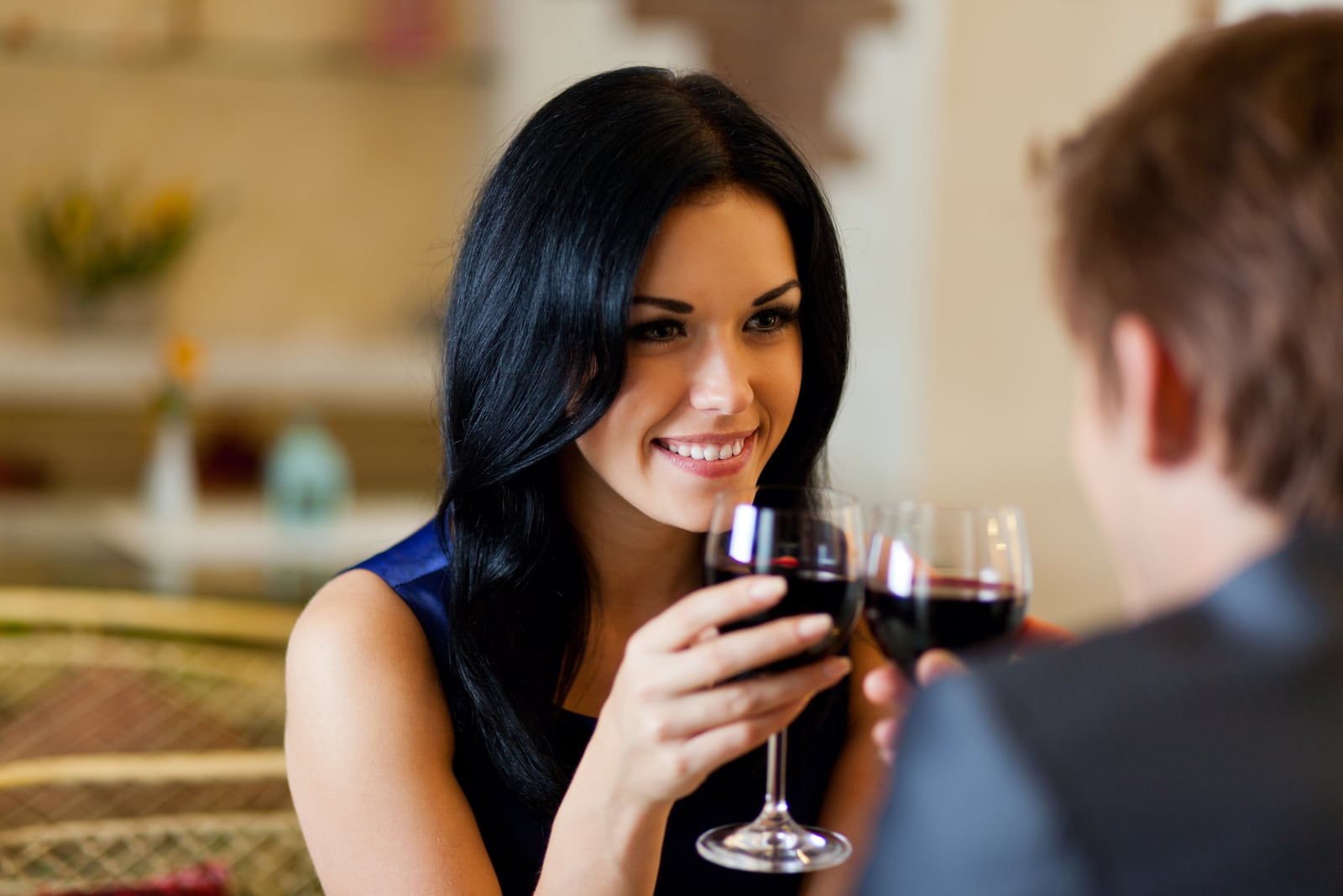 a loving couple toasts with wine and flirts