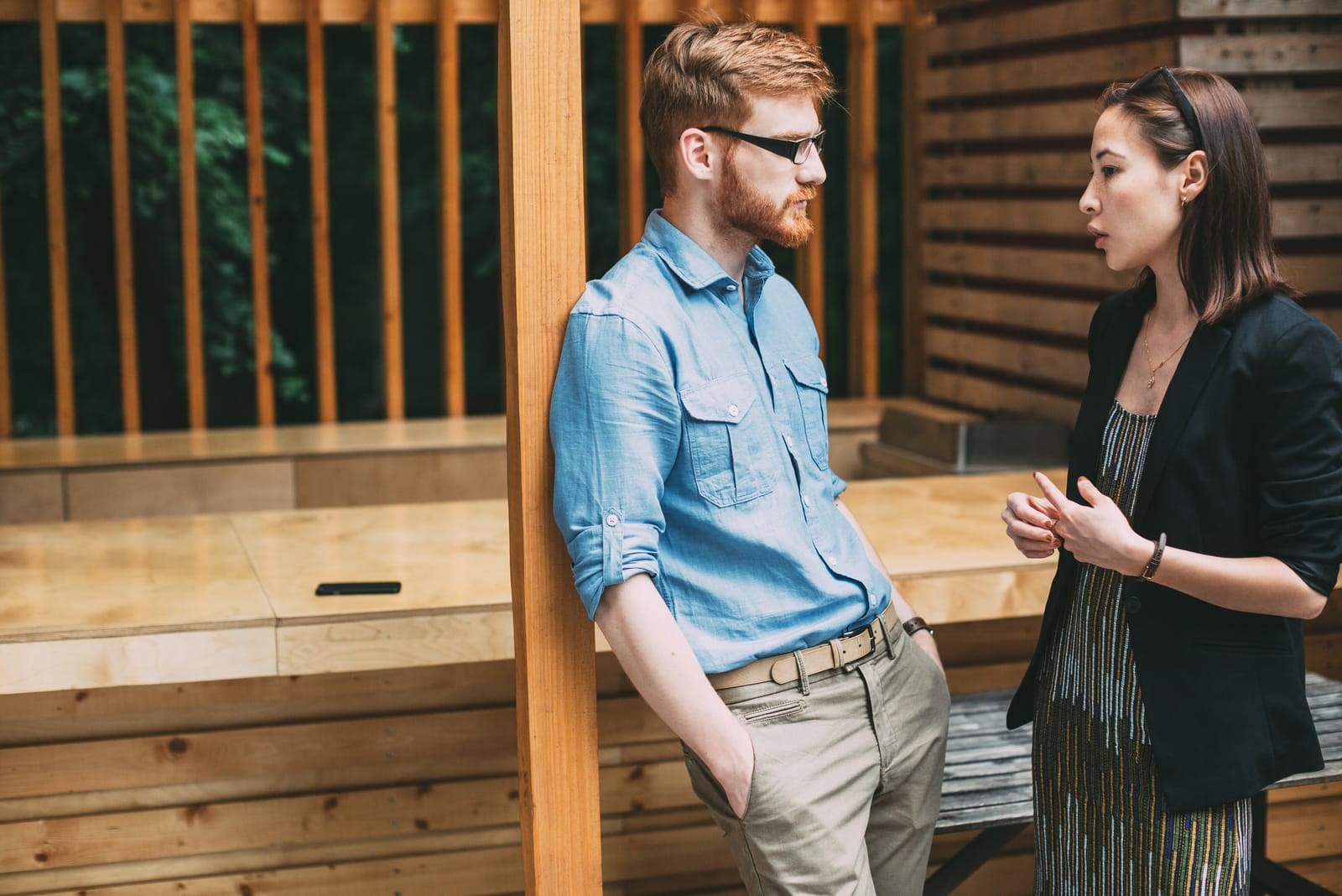 a man and a woman stand and talk