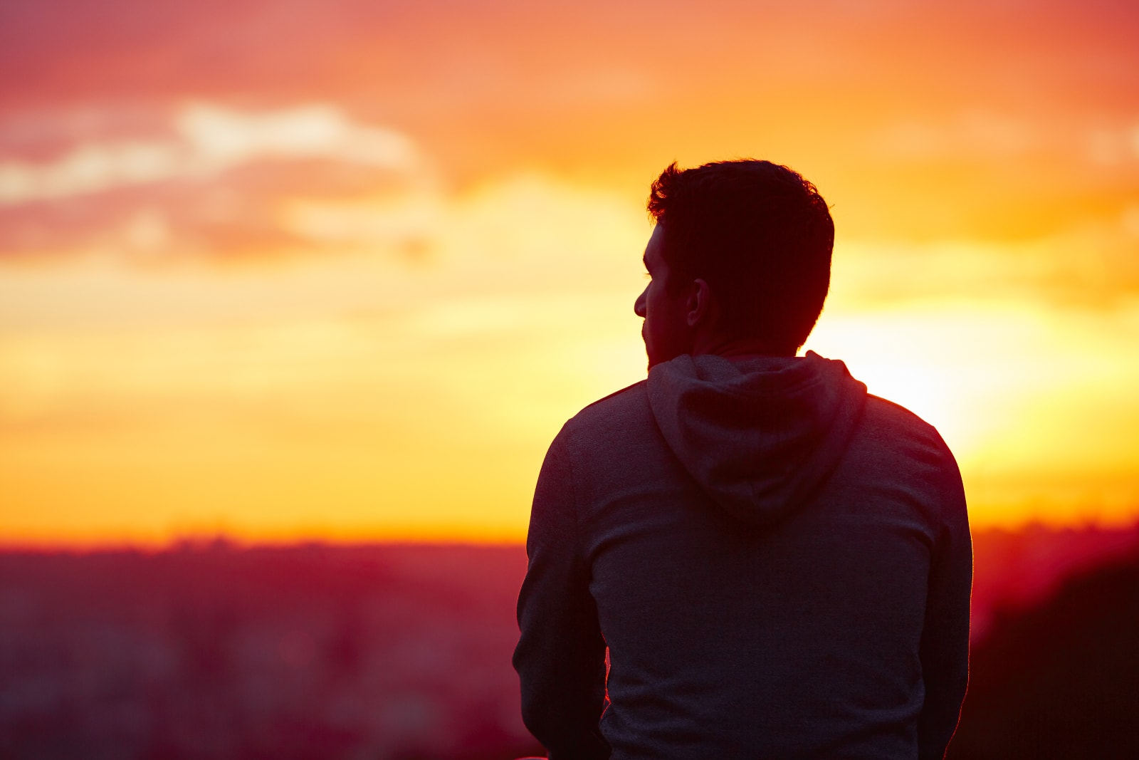 a man watches the sunset
