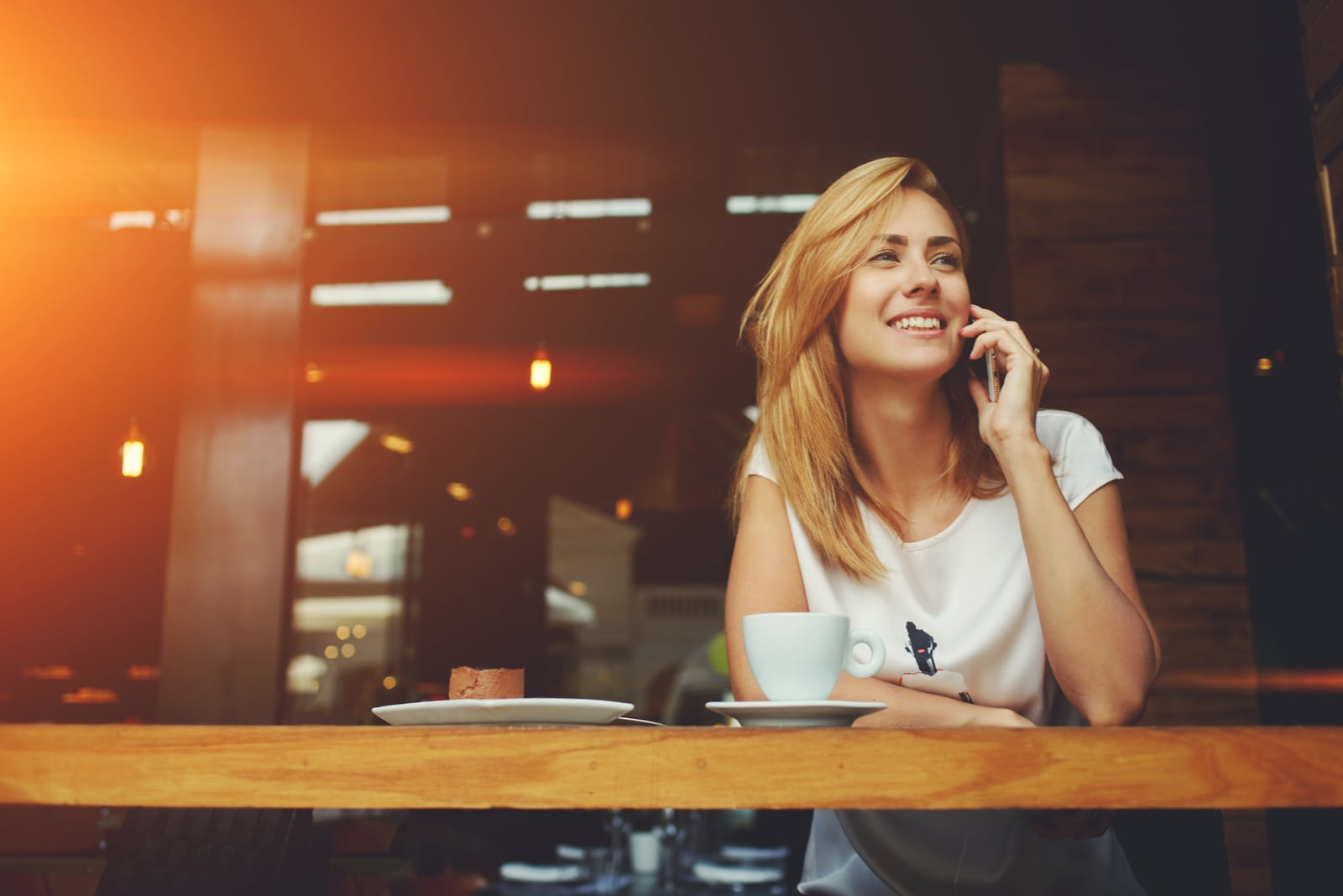 a woman talking on the phone over coffee