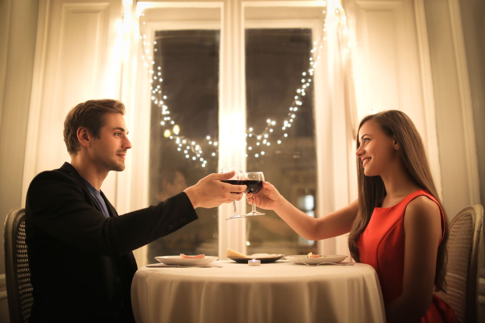 man and woman having romantic dinner at home