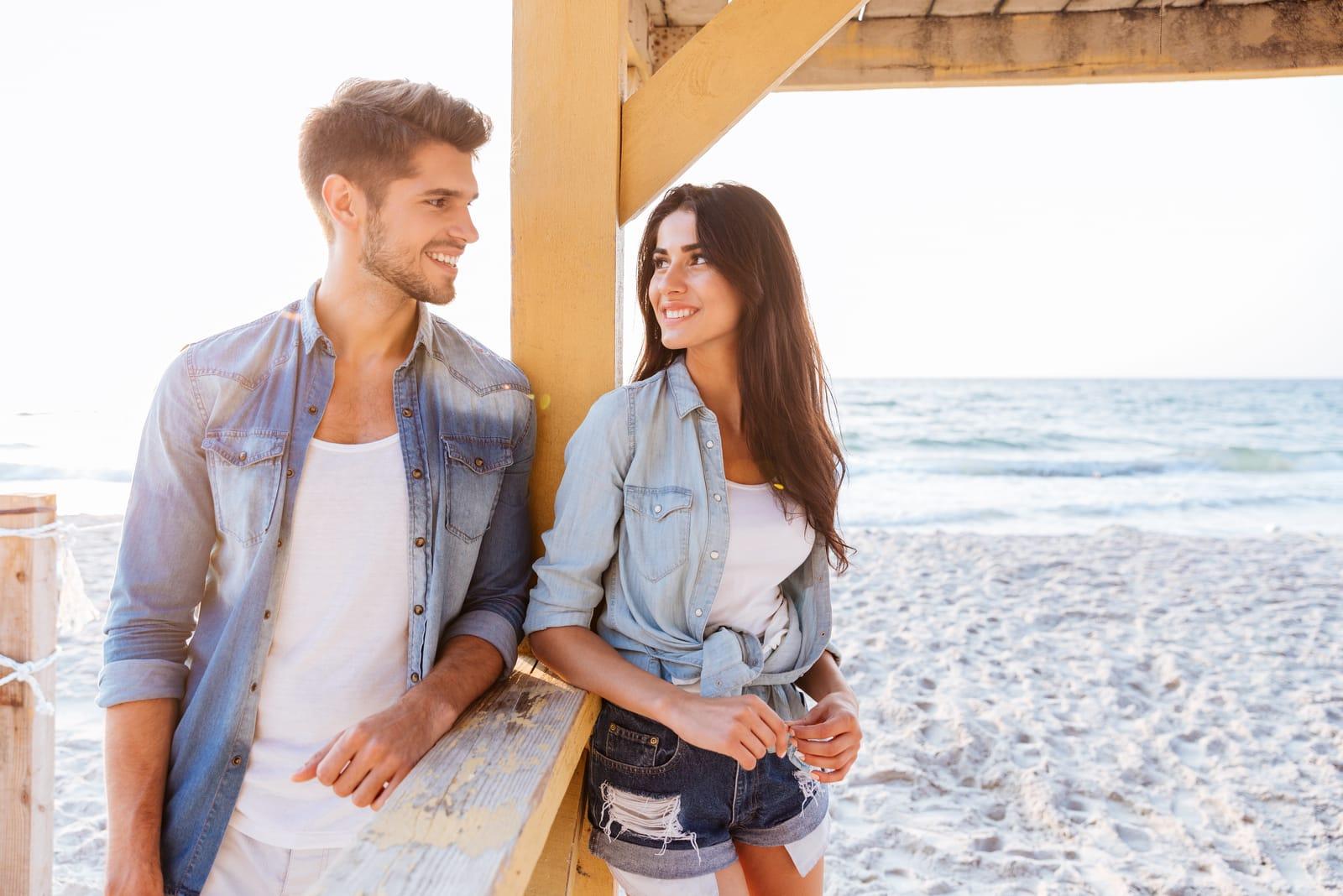 couple on the beach flirting