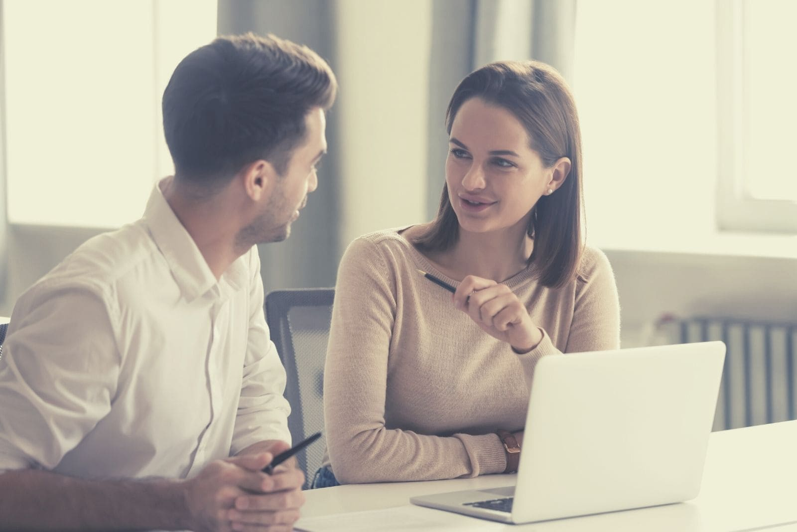 creative male and female working in the office sharing ideas