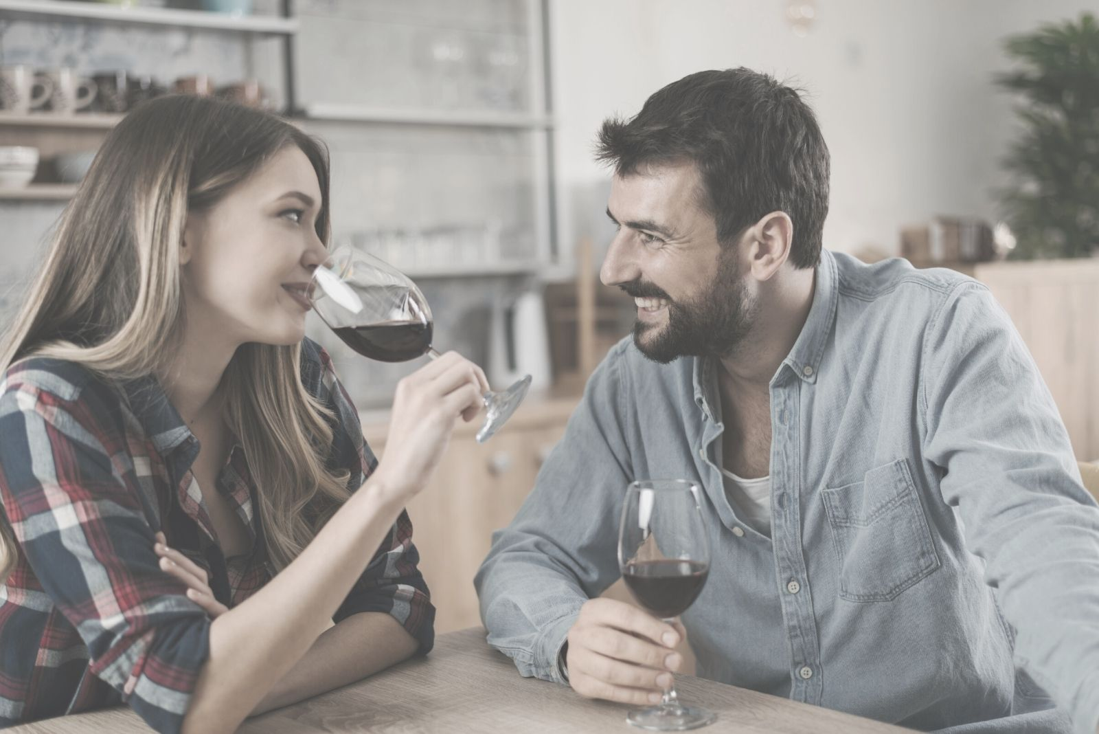 happy couple drinking wine in their homes