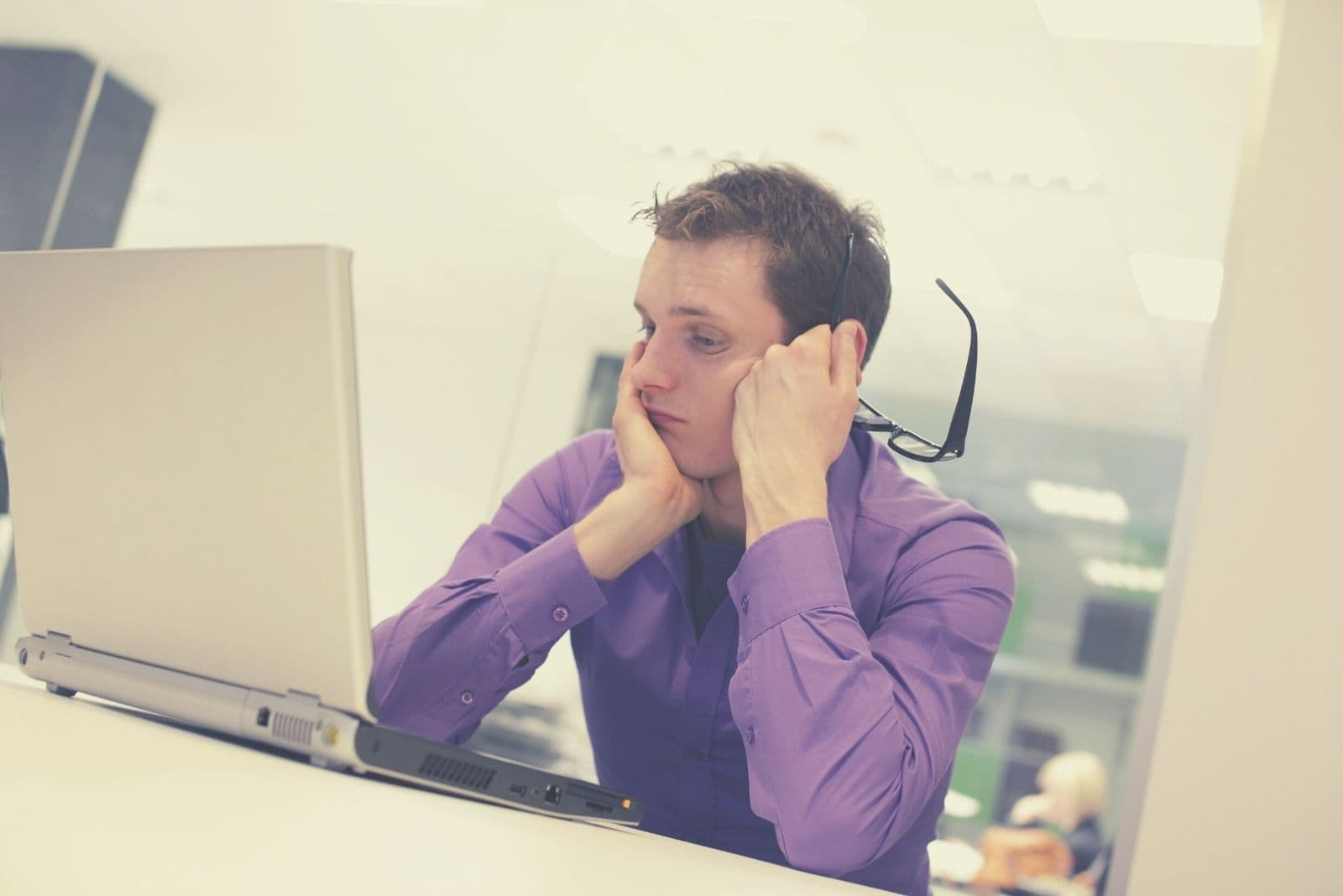 man having problems inside the office staring at his computer