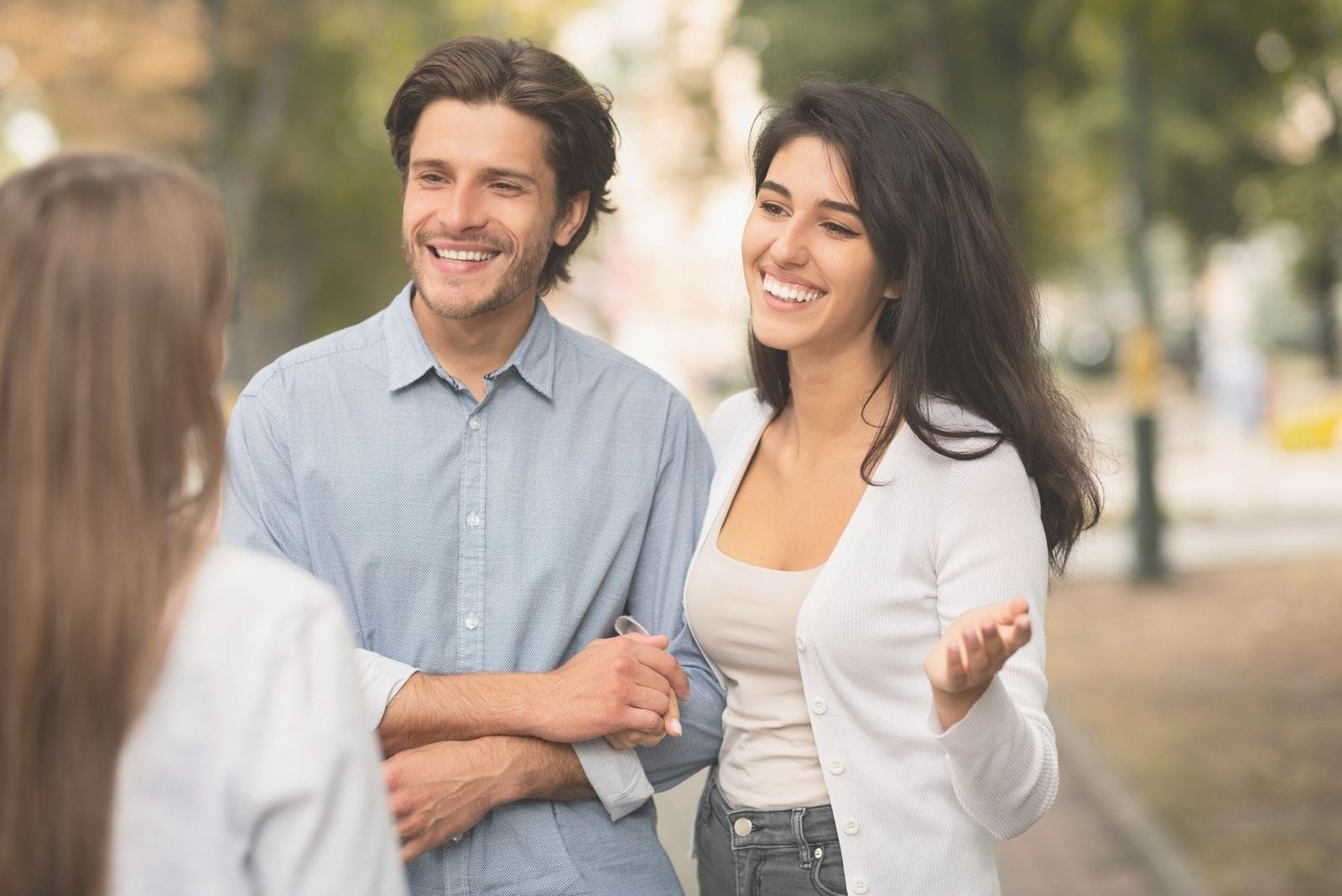 married couple meeting a single lady in the streets