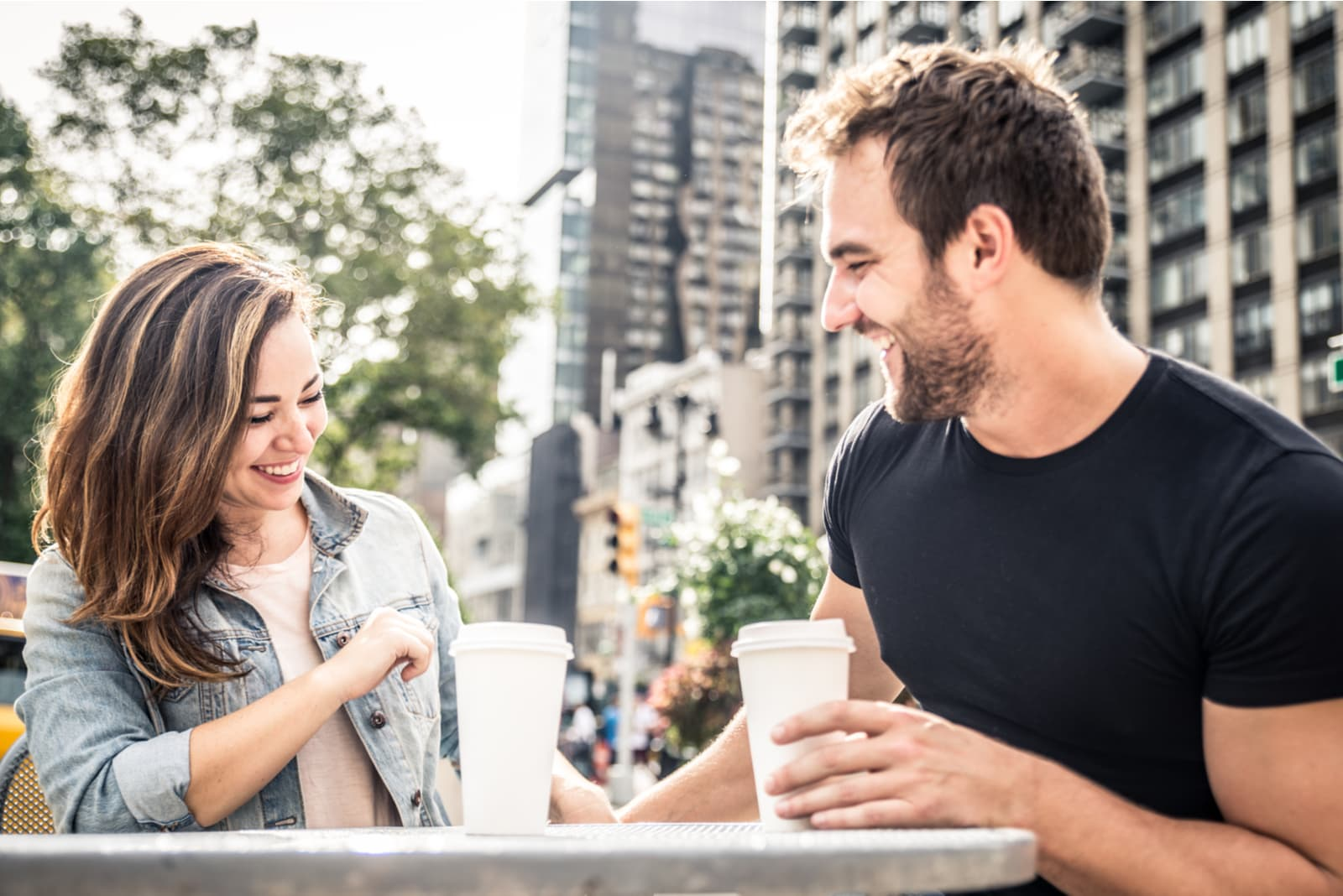 the man and woman laugh as they talk