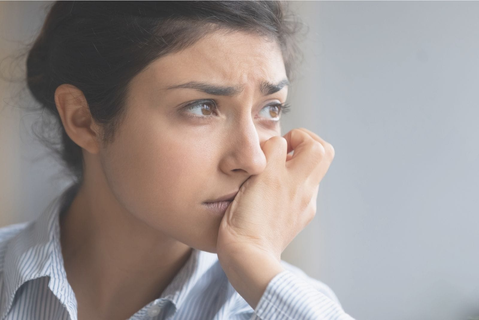unhappy indian woman overthinking in a close up image