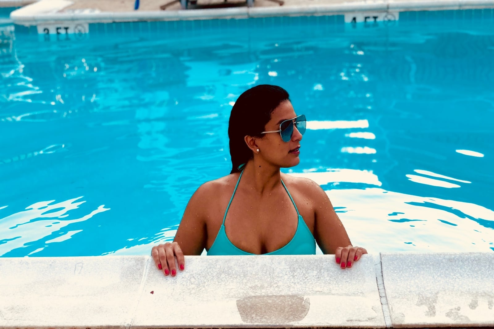 woman in blue bikini relaxing in pool