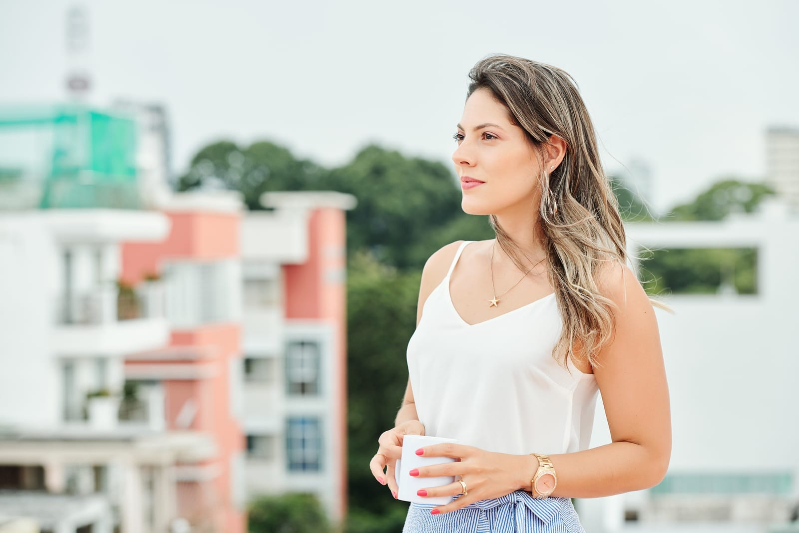 woman standing outdoors and looking away