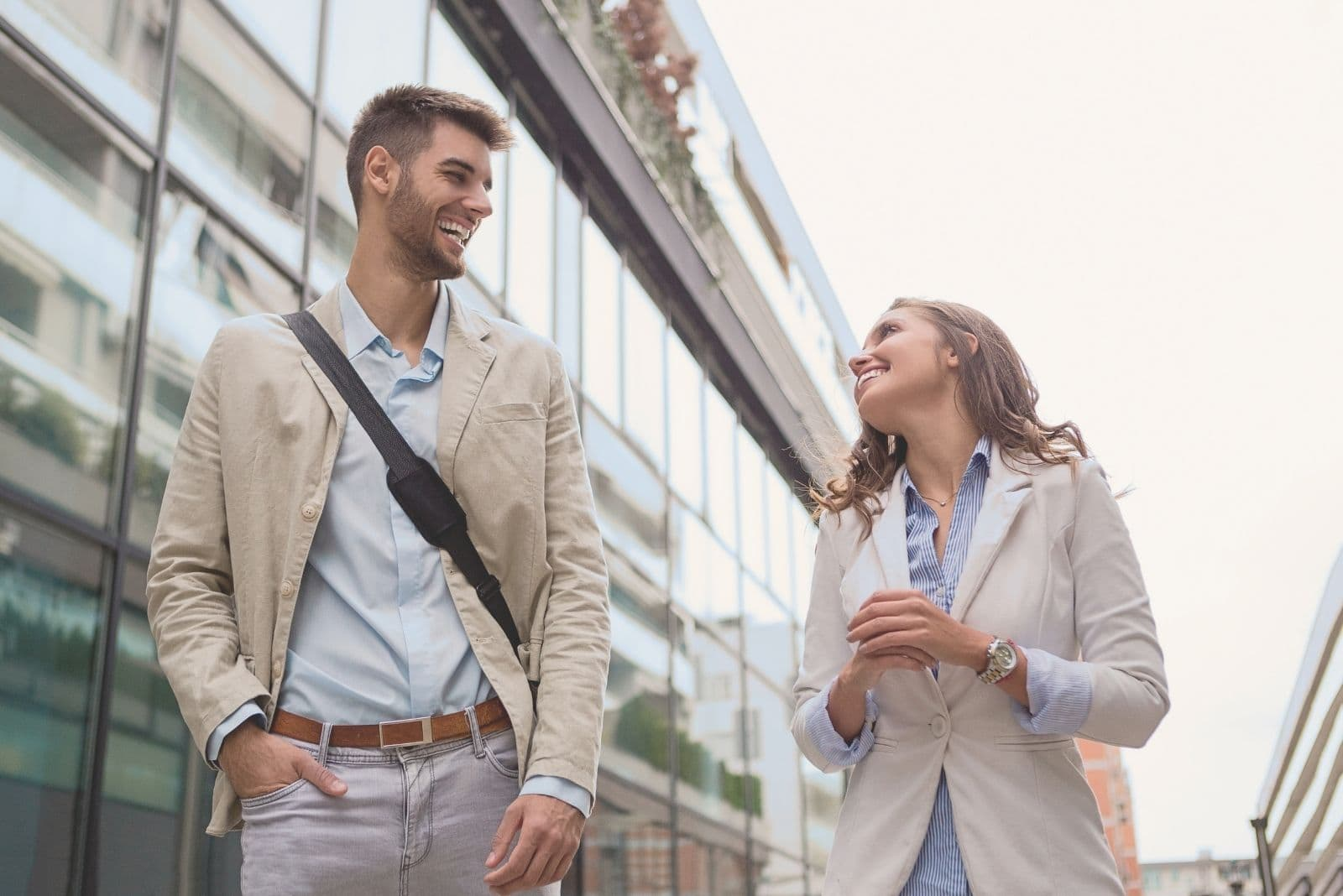 young businessman walking with a female colleague in the street outside the building