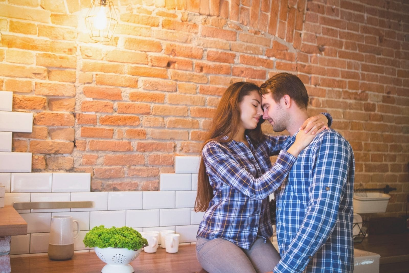 young couple hugging in the kitchen