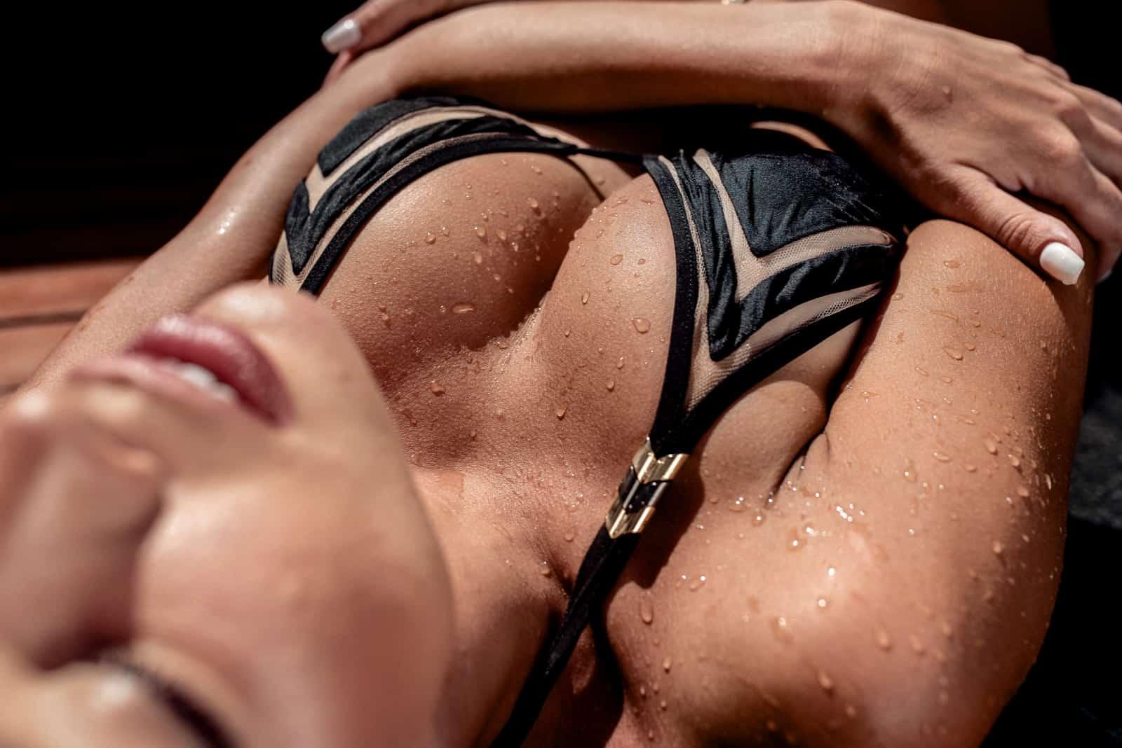 sexy latina in bikini lying wet