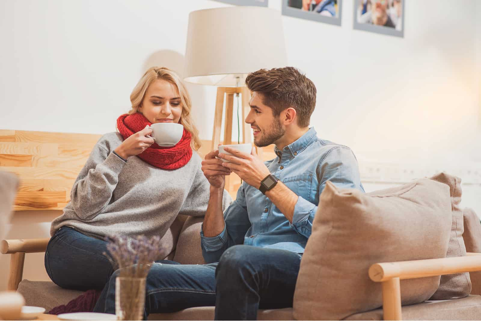 Happy man and woman enjoying hot drink
