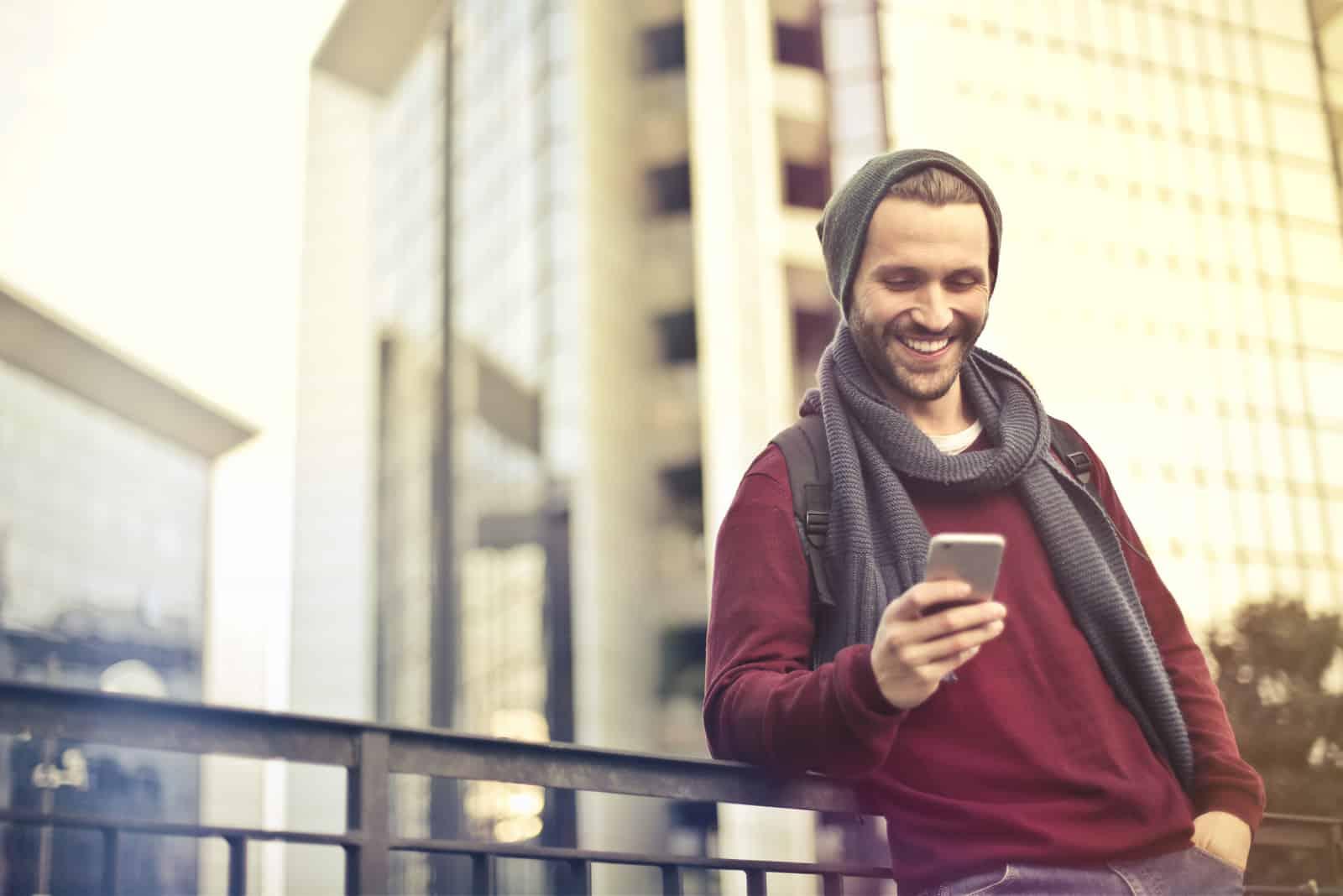 Happy man key on phone