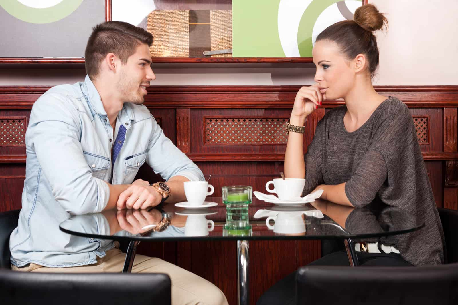 a couple in love sitting in a cafe and talking