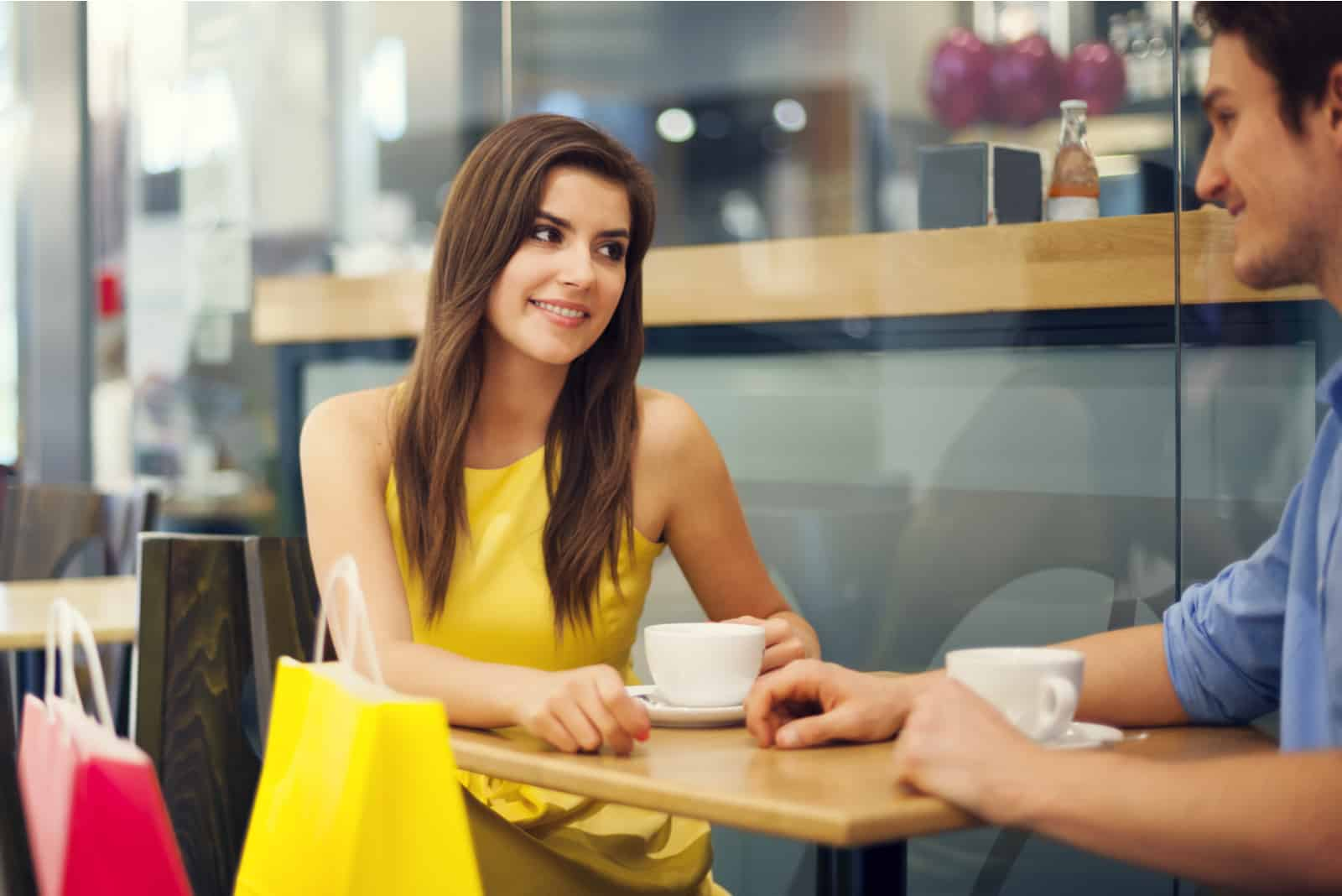 a man and a woman are sitting at a table