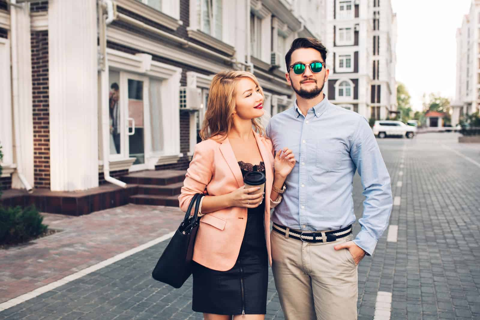 a man hugged a woman as they stood in the street