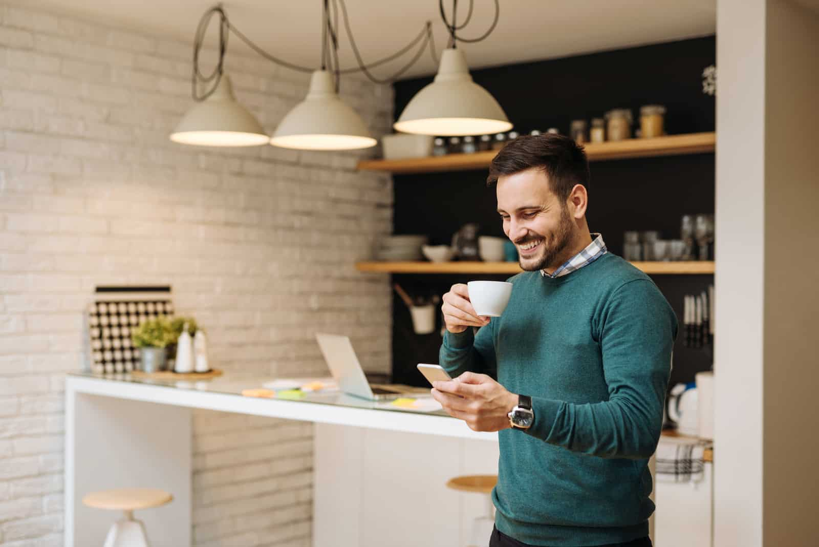 a smiled man with morning coffee button on the phone