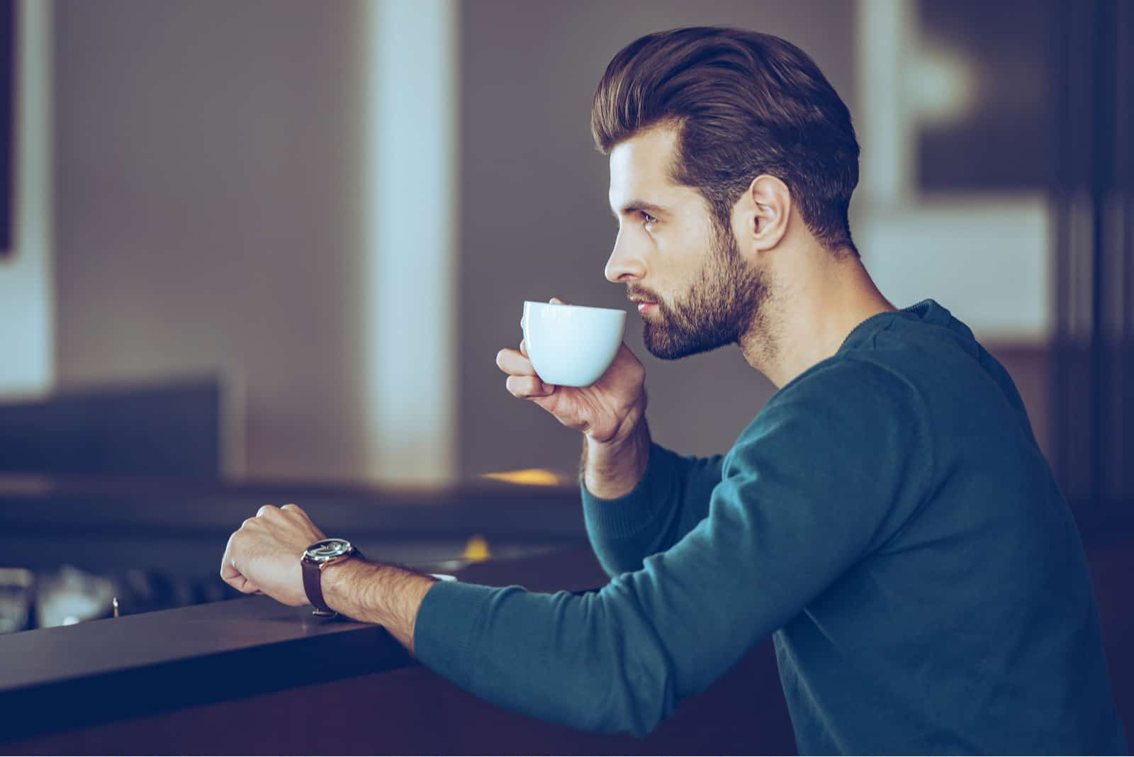 an imaginary man sits and drinks coffee