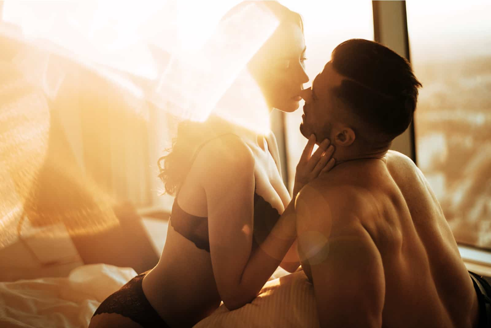 lovers make love in the room at sunset