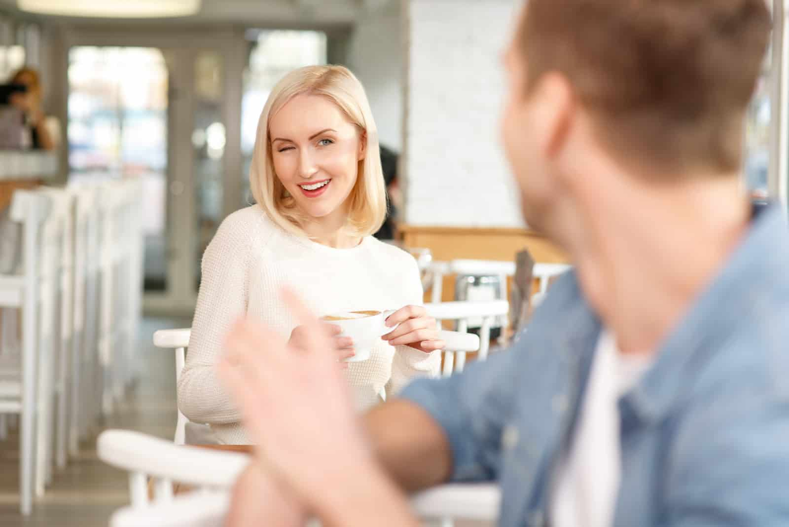 the couple flirts in a cafe