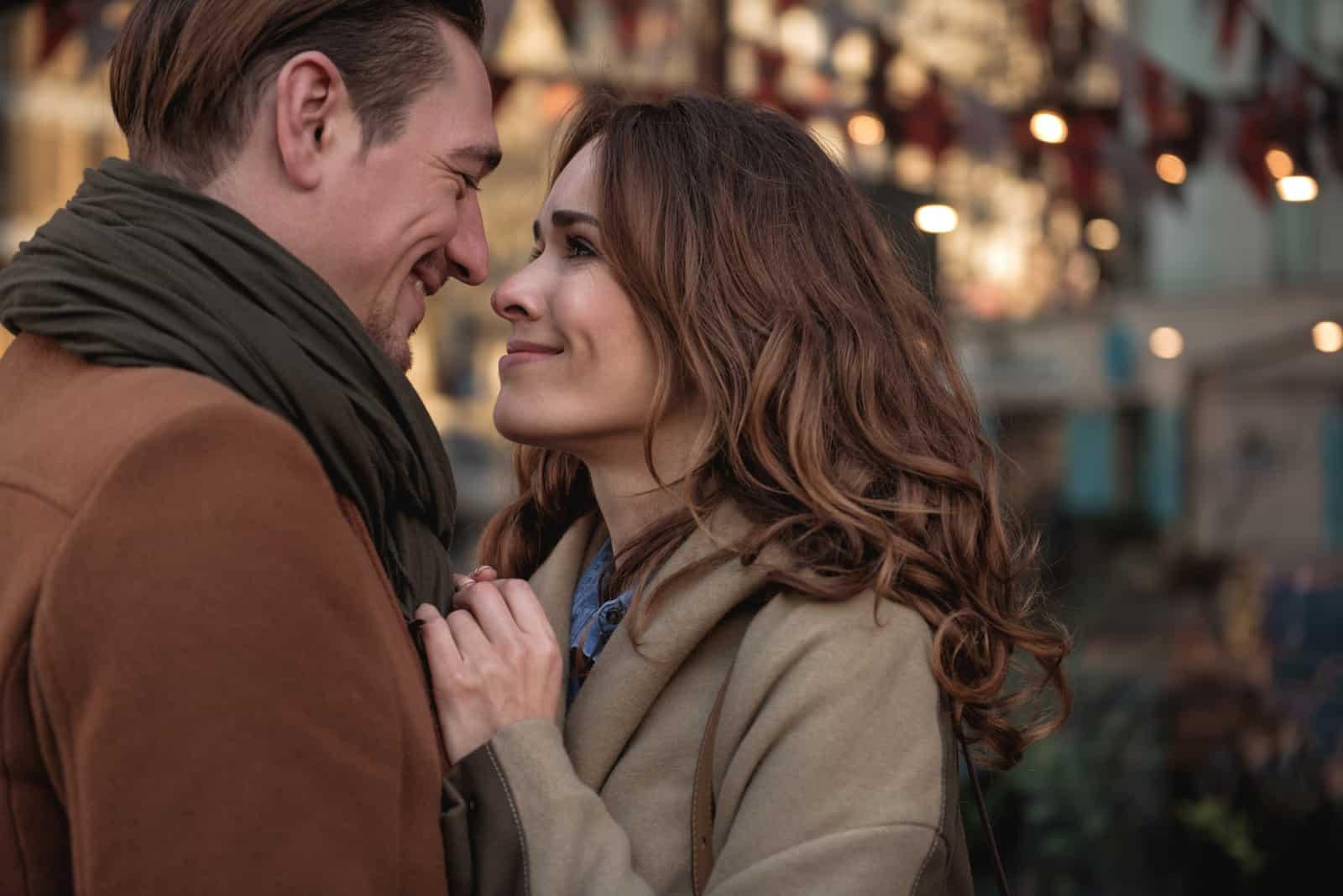 the happy couple hugs and kisses outside