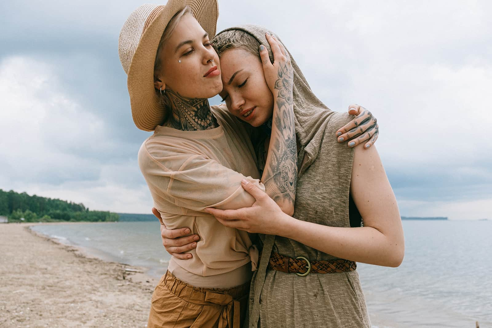 two female friends hugging on the beach