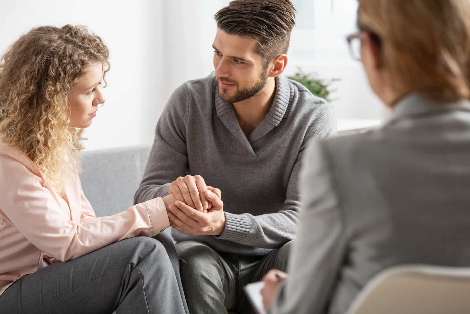 a man and a woman talk to a psychiatrist