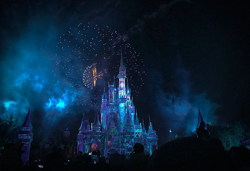 Disney crystal castle surrounded with fireworks