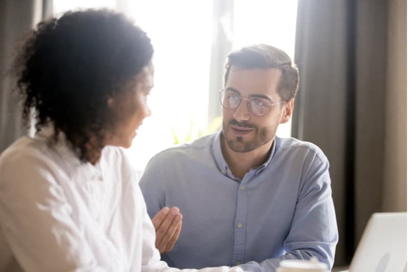 a man and a woman are talking