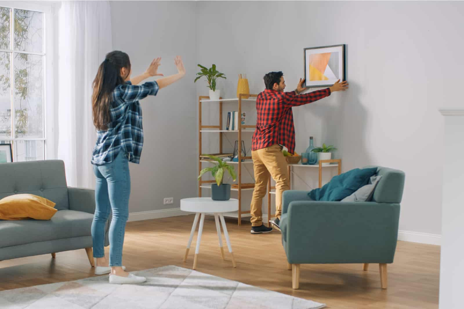 a man and a woman redecorate the house
