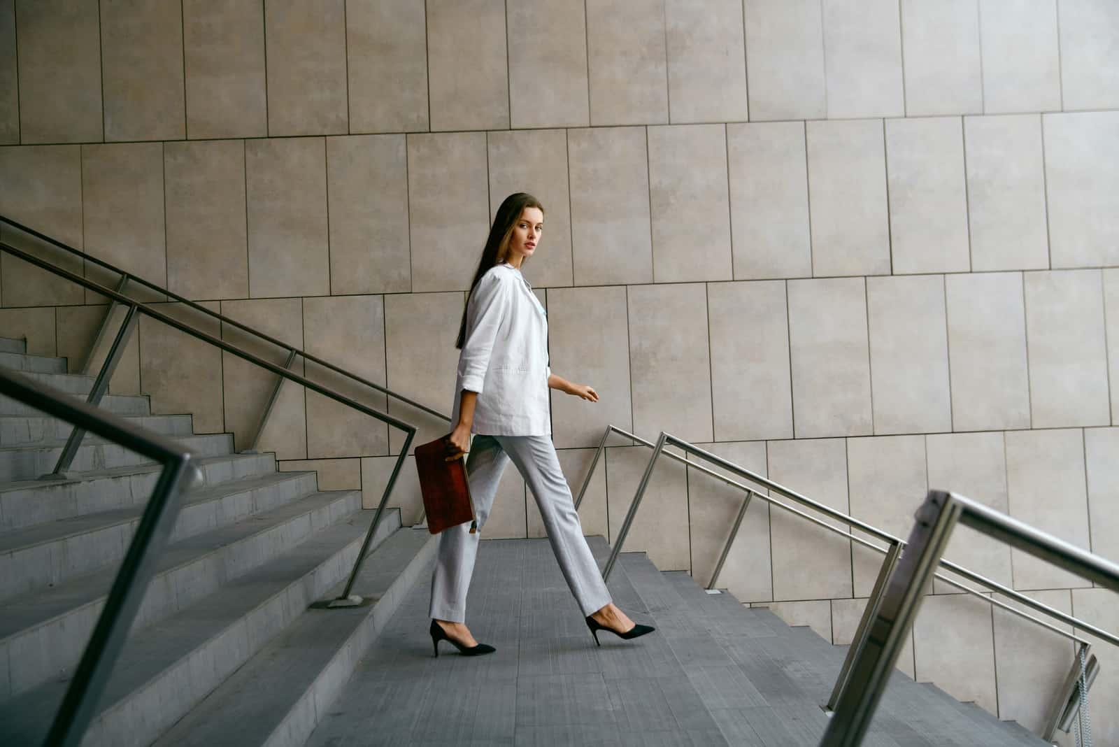 beautiful brunette stylish woman walking outdoors