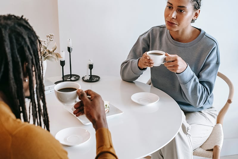 couple drinking coffee together and having conversation