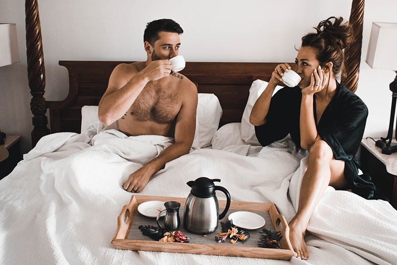 couple having coffee in the bed in the morning