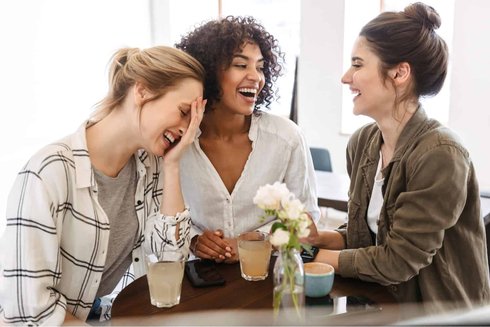 friends sit at the table and laugh