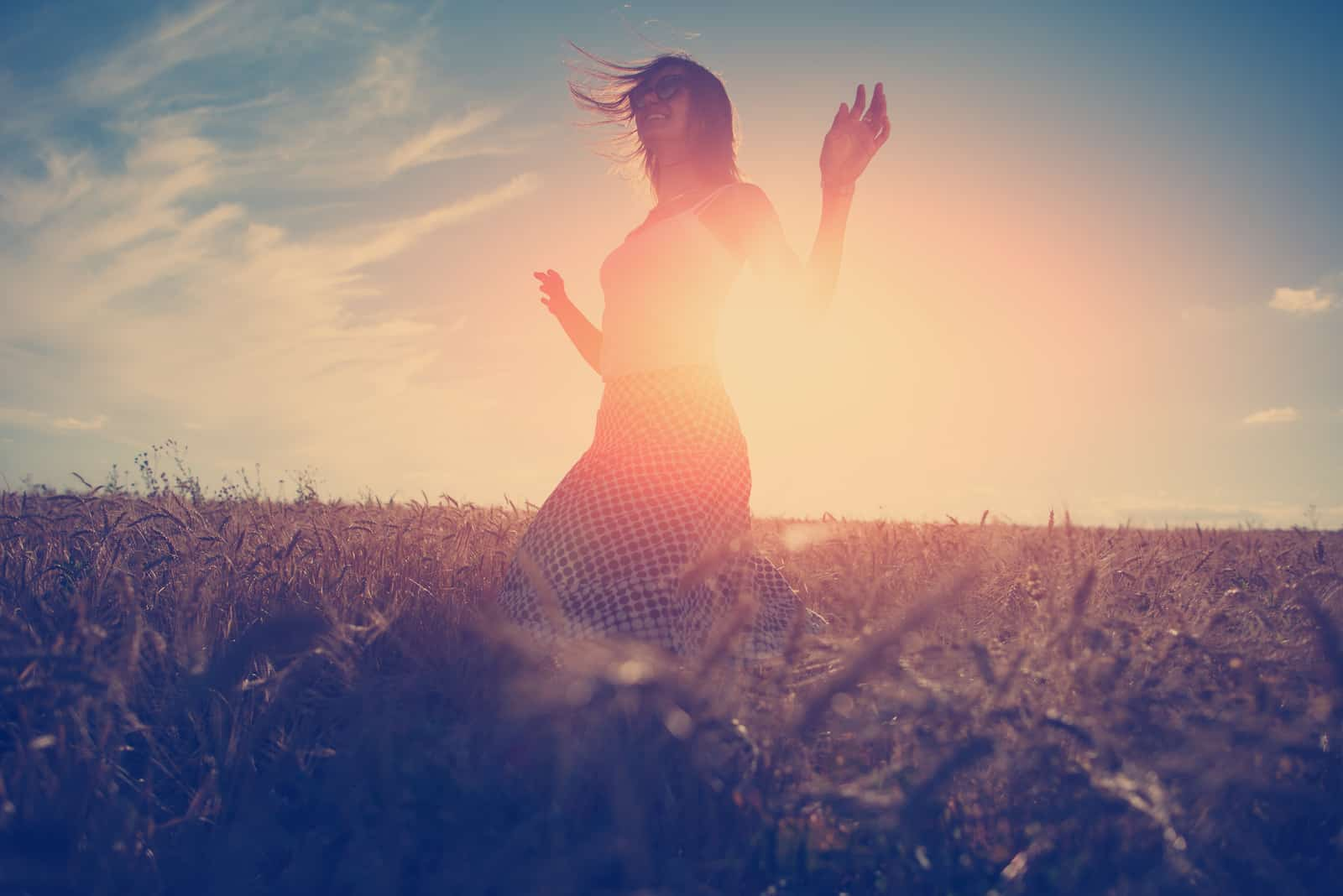 handsome girl dancing outdoors at sunset