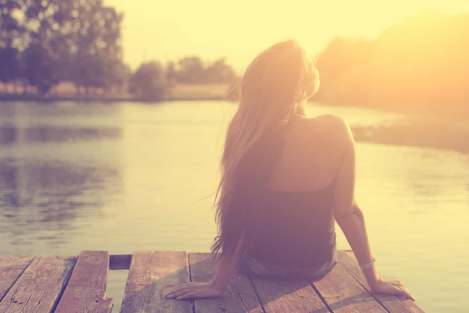 relaxing young woman in nature