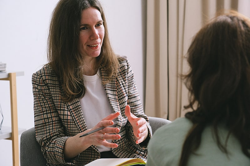 therapist talking with a woman during a session