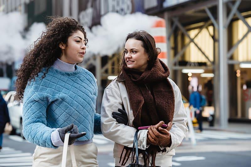 two female friends talking on the street