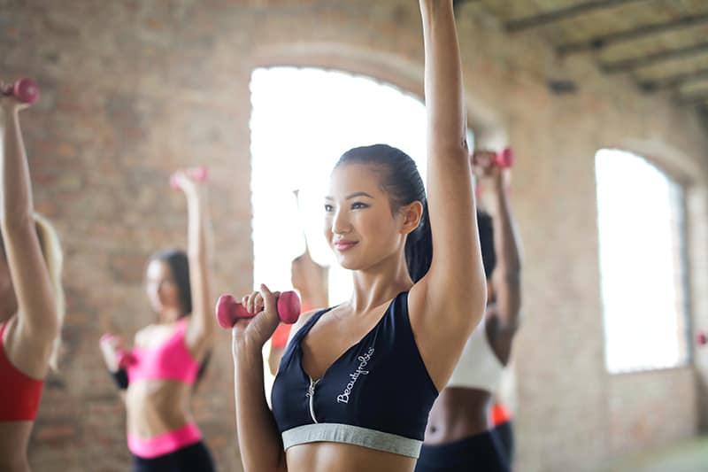 woman doing workout with dumbbells