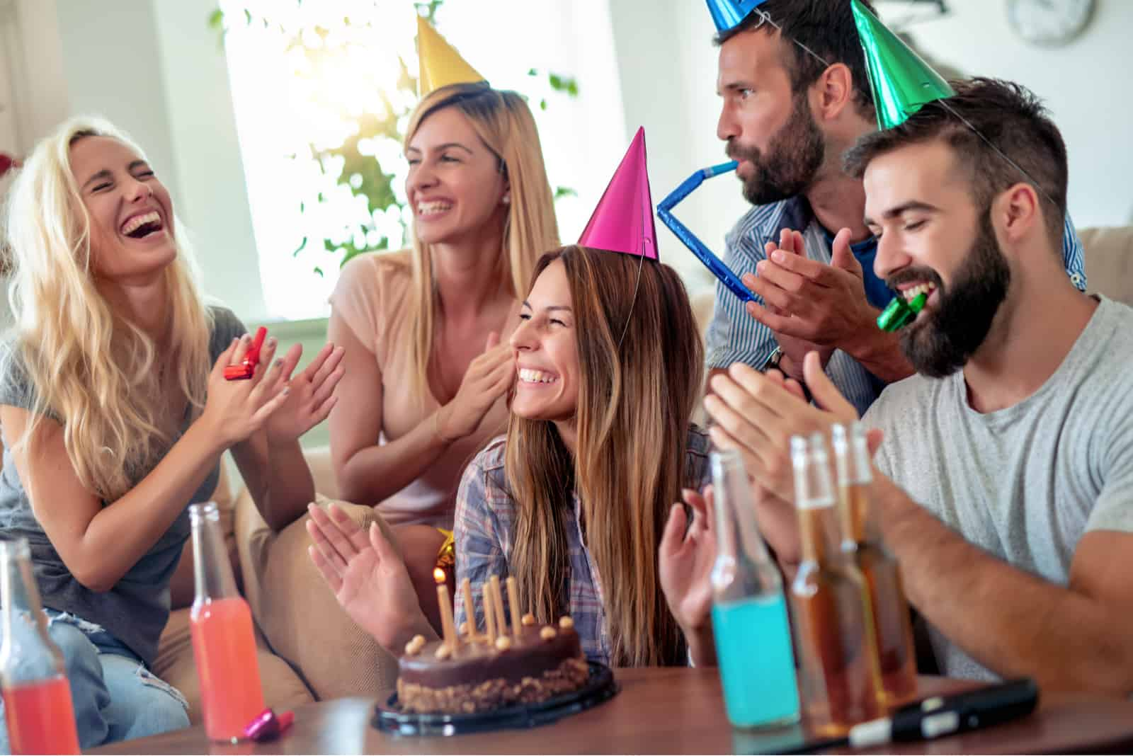 friends sit and celebrate a birthday