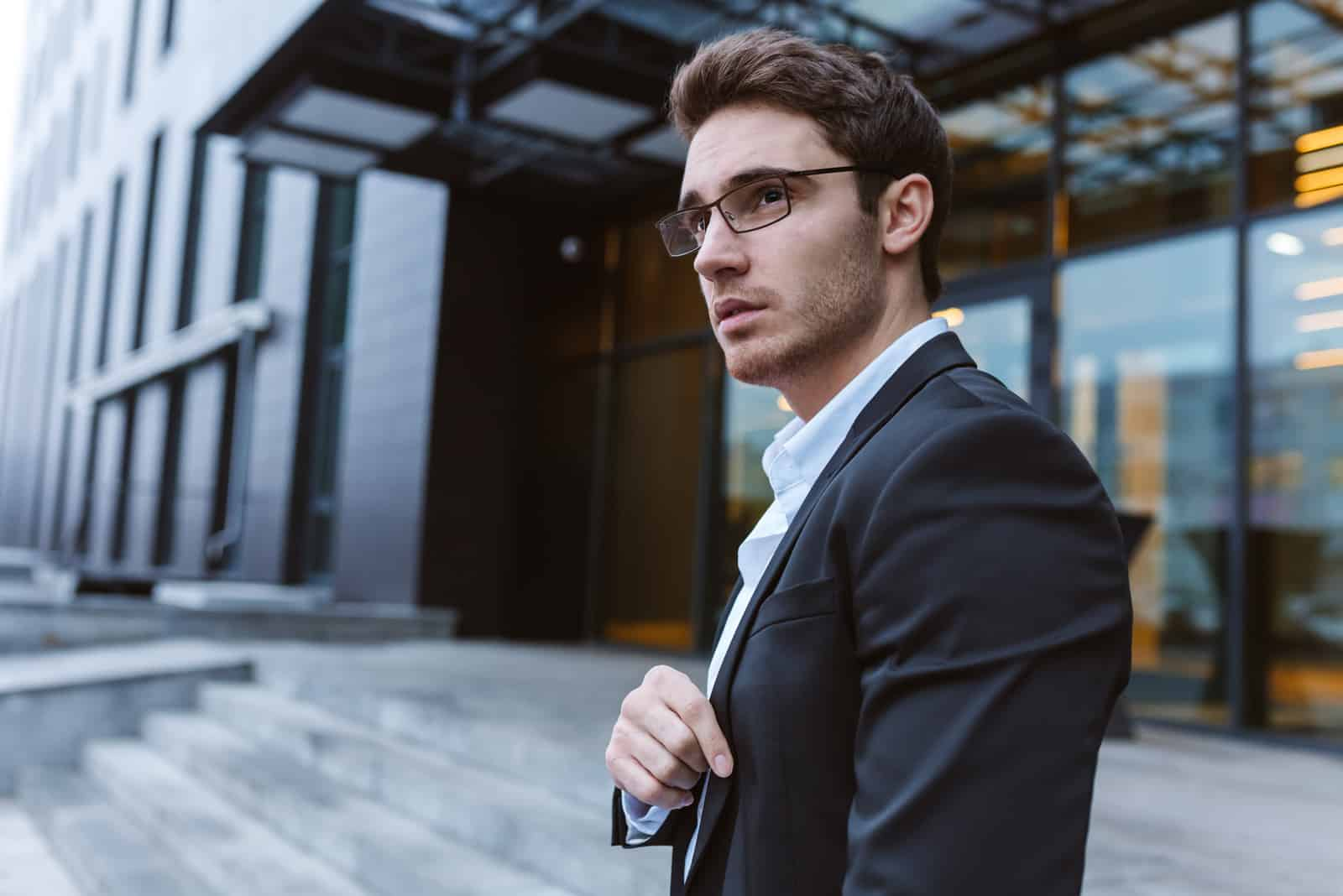 Businessman in suit and glasses standing outdoor