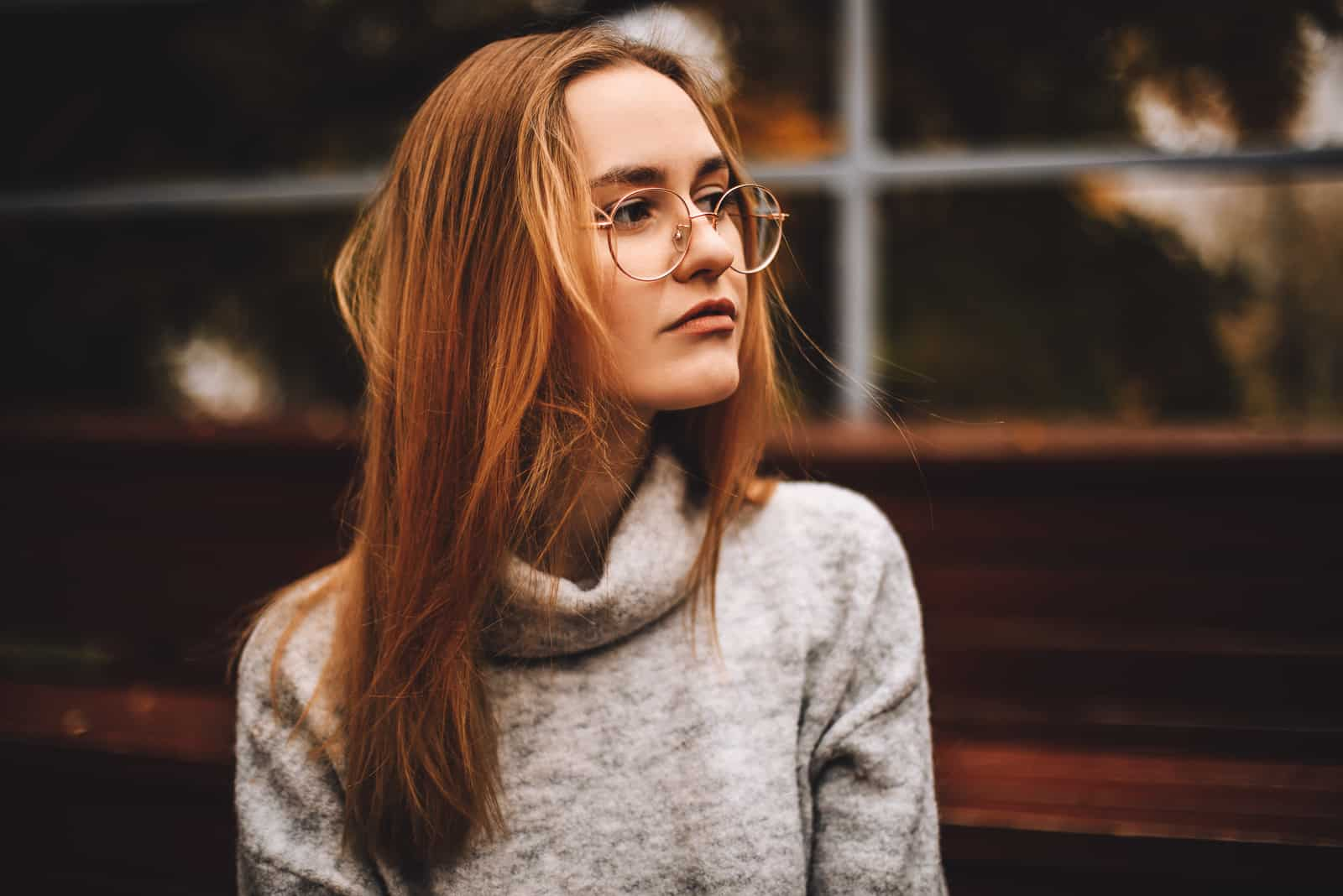 Woman wear warm grey knitted sweater and glasses