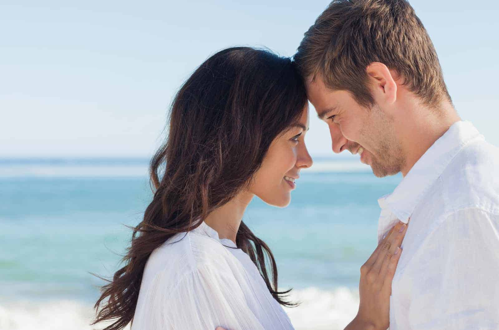 couple at the beach looking at each other
