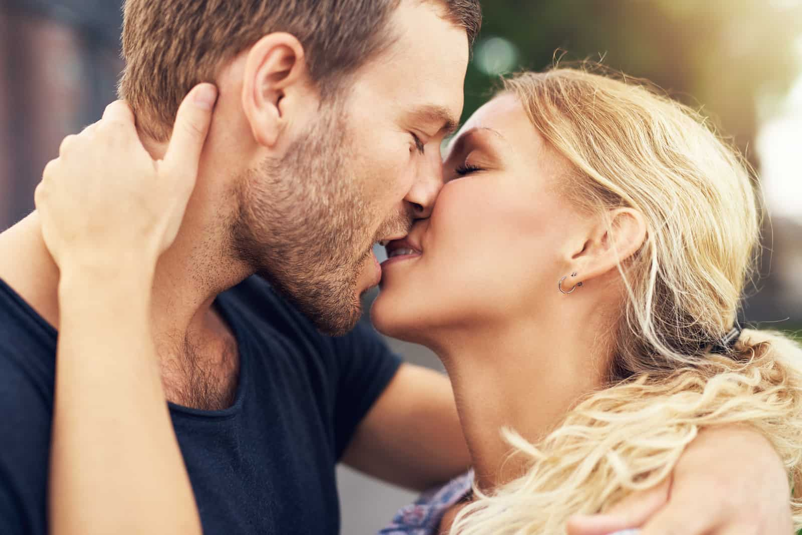 couple deeply in love sharing a romantic kiss,
