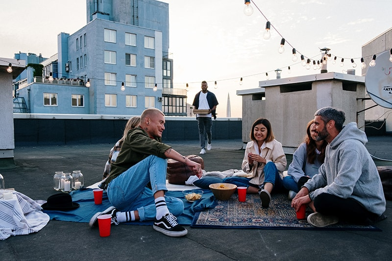 group of friends hanging out on the rooftop of the building