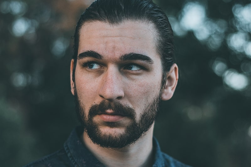 handsome bearded man looking aside