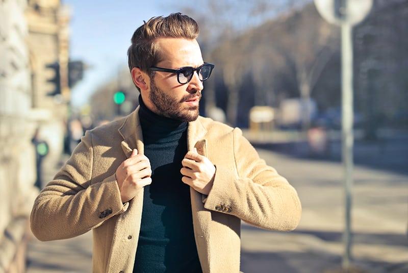 handsome man wearing brown jacket walking on the street